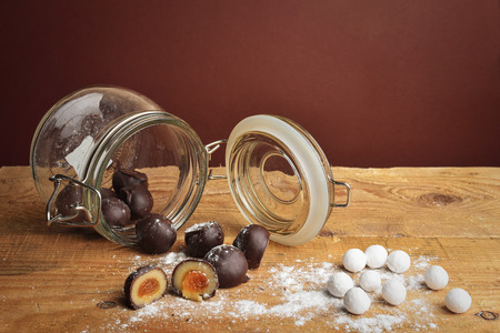 topple: chocolate candies in a glass jar Stock Photo