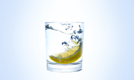 Lemon splashes in a water glass