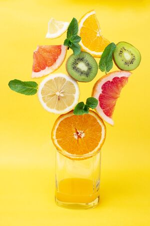 Citrus fruit on a yellow background