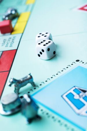 Colored board game figures with dice Banque d'images