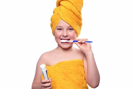A boy without one tooth with a toothbrush isolated on a white background Reklamní fotografie