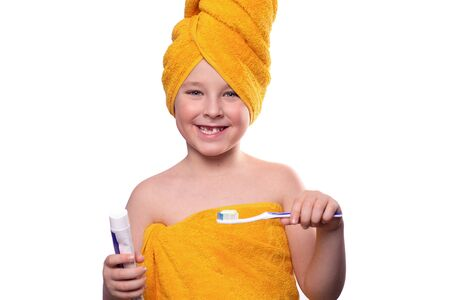 A boy without one tooth with a toothbrush isolated on a white background, a child brushing his teeth