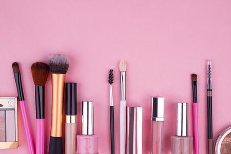 Decorative cosmetics, set of cosmetics on a pink background Reklamní fotografie