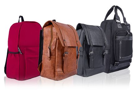 A number of backpacks of different colors on a white background Reklamní fotografie