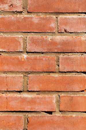 Background of old red brick stone wall texture