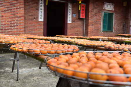 Process of Making Dried Persimmon during Windy Autumn Stock fotó