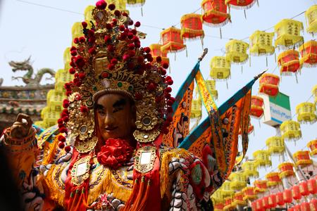 Changhua, Taiwan - MAR 25, 2177: Lukang Mazu Temple fair. The Taoist spirit medium or shaman takes the sword and flag in a traditional temple fair. Redakční
