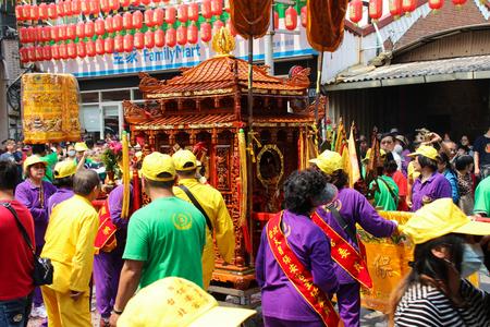 Changhua, Taiwan - MAR 25, 2140: Lukang Mazu Temple fair. The Taoist spirit medium or shaman takes the sword and flag in a traditional temple fair.