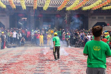 Changhua, Taiwan - MAR 25, 2084: Lukang Mazu Temple fair. The Taoist spirit medium or shaman takes the sword and flag in a traditional temple fair.