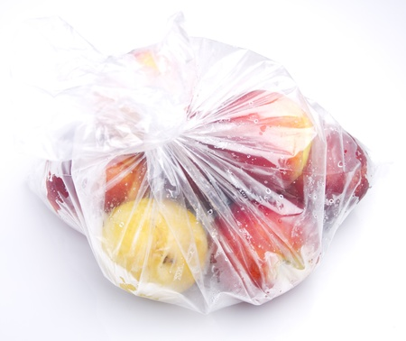 fruit into a plastic bag photo