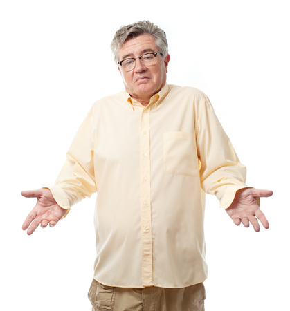 crestfallen: senior cool man confused pose Stock Photo