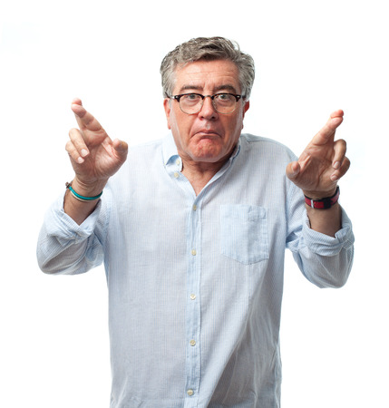 hope indoors luck: senior cool man finger crossing Stock Photo