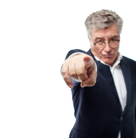 provoked: senior cool man angry boss pointing Stock Photo