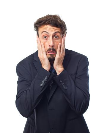 nervousness: young crazy businessman scared pose