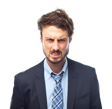 visage d homme: jeune homme d'affaires folle visage en colère