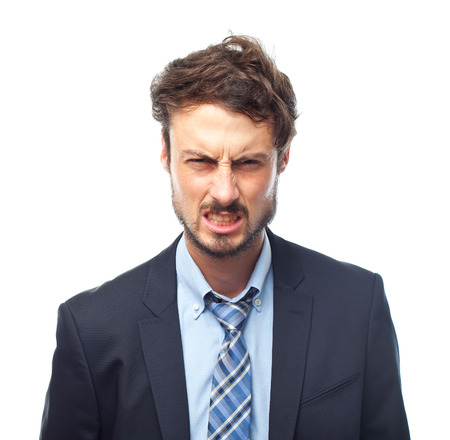 angry businessman: young crazy businessman angry face Stock Photo
