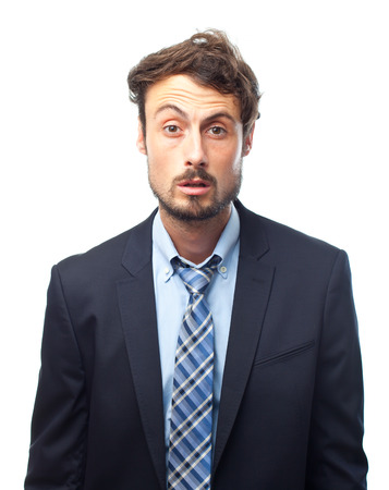 questionable: young crazy businessman confused face Stock Photo