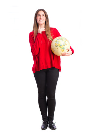 world thinking: young cool girl thinking with world globe
