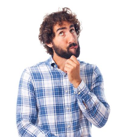 dudando: joven hombre dudando