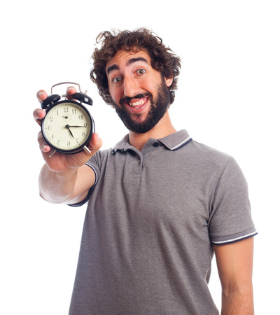 young bearded man with a clock Stock Photo