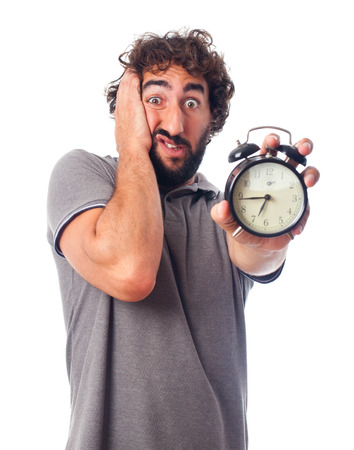 humoristic: young bearded man with a clock Stock Photo