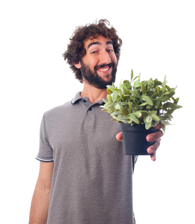 young bearded man with a plant