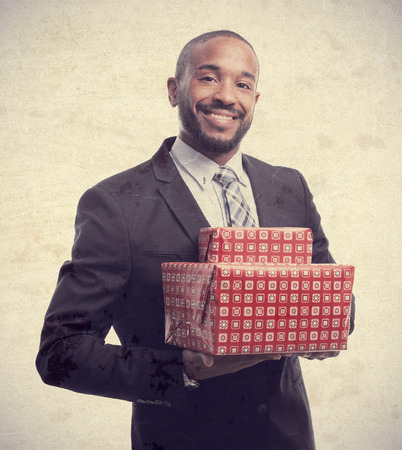 young cool black man with gift boxes photo