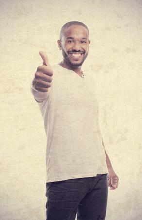 conform: young cool black man all rignt sign