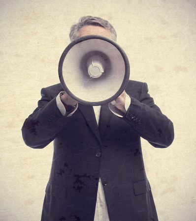 senior cool man with a megaphone Stock Photo