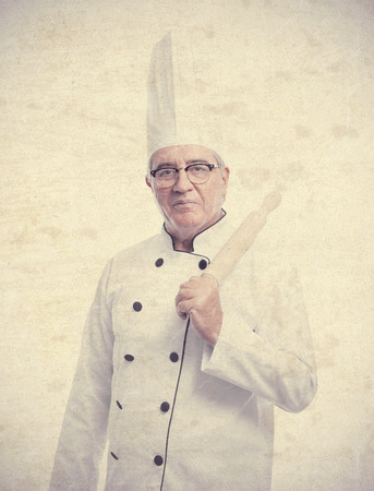 cheff: senior cool man with a kneader