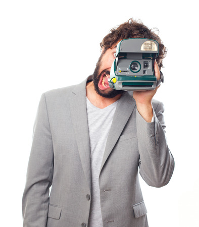 young crazy man with a camera photo