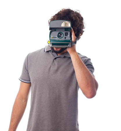 young crazy man with a photo camera instant photo
