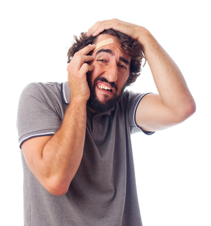 young crazy man with head pain photo