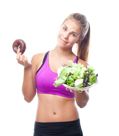 sportwoman: young cool woman with donut and salad