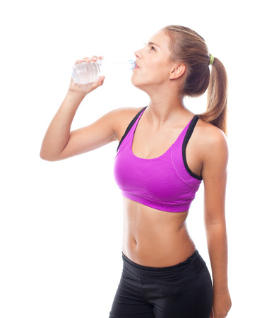sportwoman: young cool woman drinking water Stock Photo