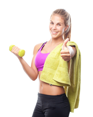 exersice: young cool woman with a dumbbell and a towel