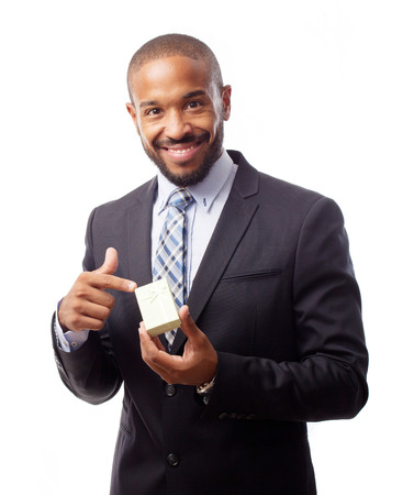 young cool black man with gift box photo