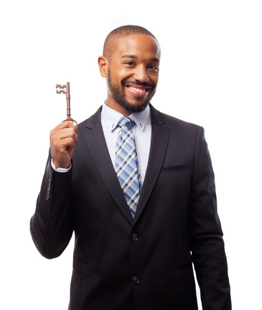 young cool black man with an old key Stock Photo