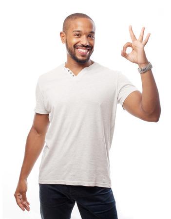 posing  agree: young cool black man okai sign Stock Photo