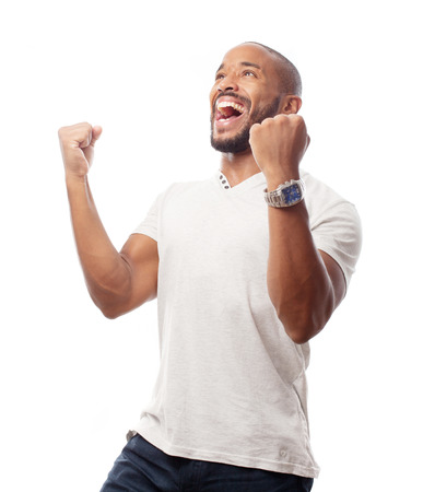 excited man: young cool black man celebratin sign Stock Photo