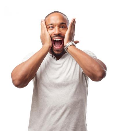 cara sorprendida: joven hombre negro fresco sorprendió Foto de archivo