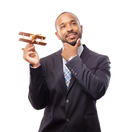 black man thinking: young cool black man thinking with wooden plane Stock Photo