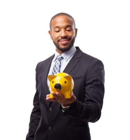 young cool black man with a piggy bank Stock Photo