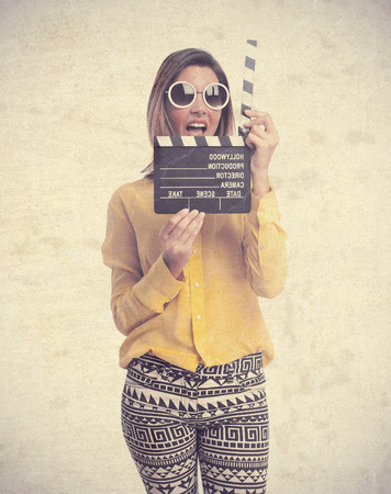 young cool woman with a clapperboard