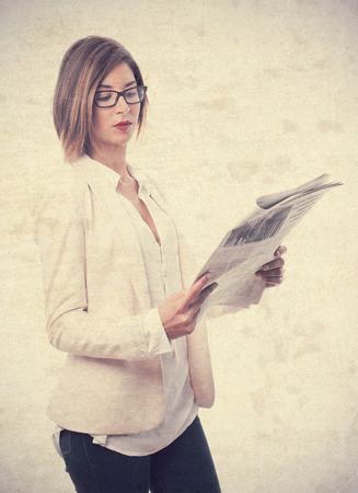 young cool woman with newspaper Stock Photo