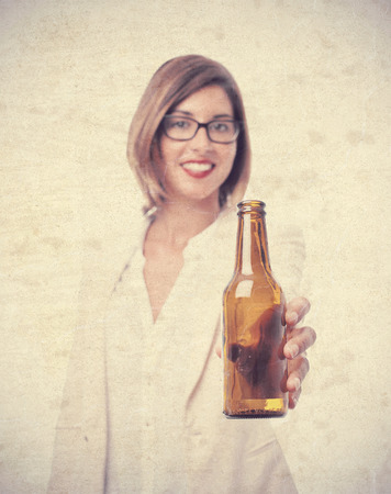 young cool woman offering a beer Stock Photo