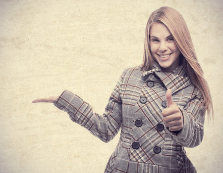 conform: young cool woman all right and showing gesture