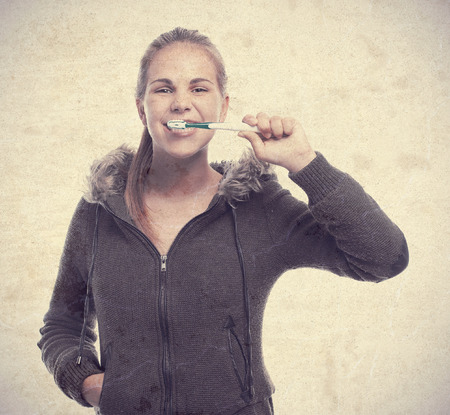 tongue cleaner: young cool woman brushing her teeth