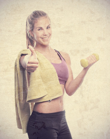 sportwoman: young cool woman with a dumbbell and a towel