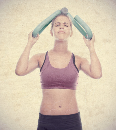 exersice: young cool woman with a dumbbell